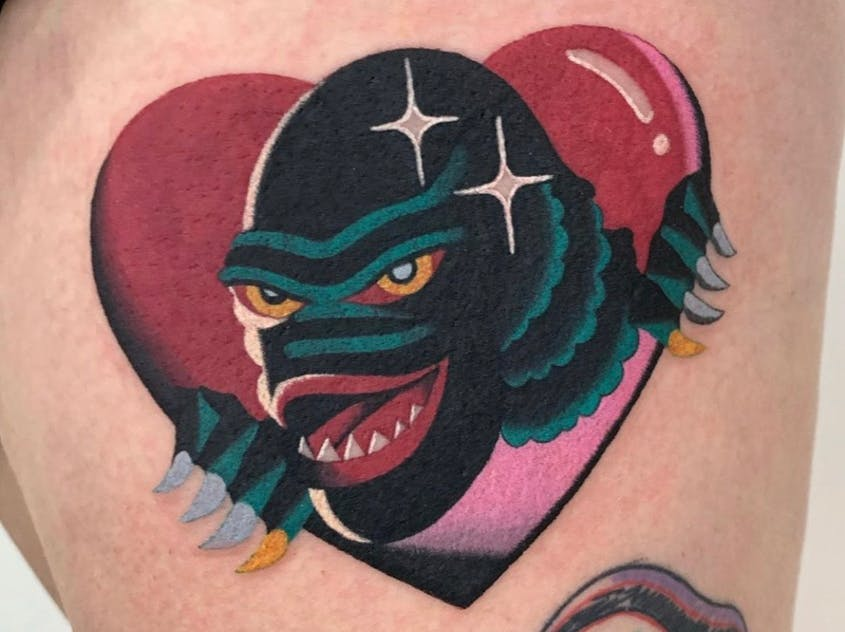 At Temperance Tattoo in San Francisco, artist Cho specializes in merging pop culture icons such as the Creature from the Black Lagoon with a color-saturated style.