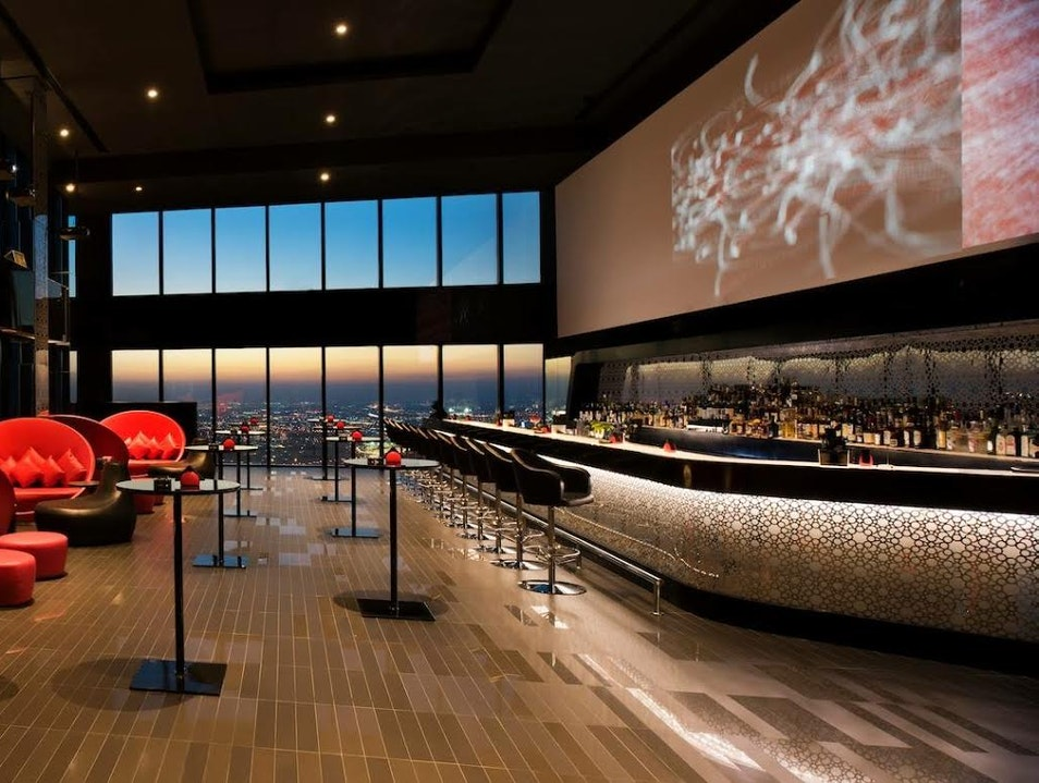 Sipping a drink from the highest bar in Doha