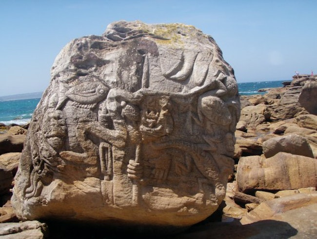 Gorgeous carved rocks off of a beautiful beach