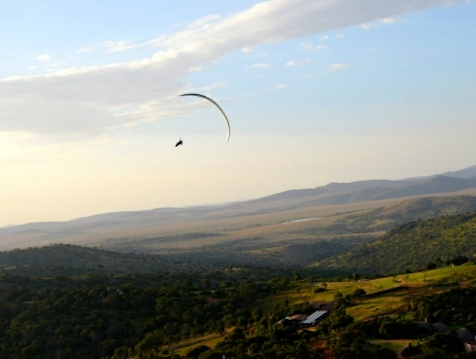 Paragliding over Borana's dusky mountains Laikipia  Kenya