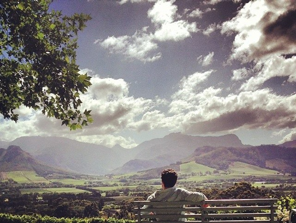 Enjoy the view – and a glass – at La Petite Ferme Franschhoek  South Africa