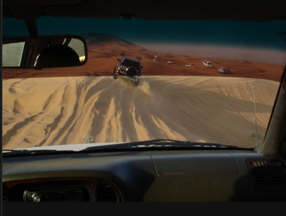 Driving in the Sand Dunes of Dubai