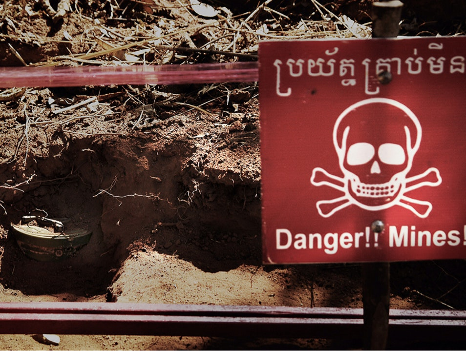 explore Cambodia and volunteer/help w/ landmine problems.  Phnom Penh  Cambodia