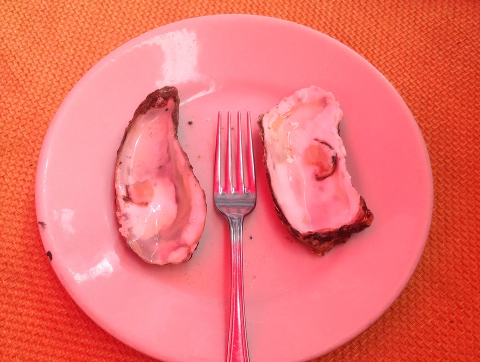Eat fresh oysters in Catania's fish market
