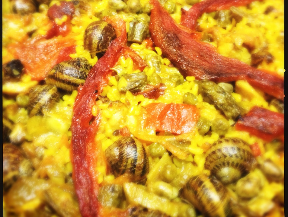 Paella of rabbit and snails.