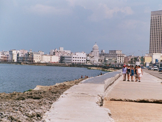 Walking along the Malecón in Havana