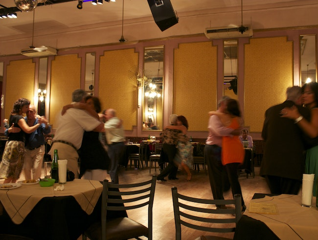 Watch real-life tango at a milonga