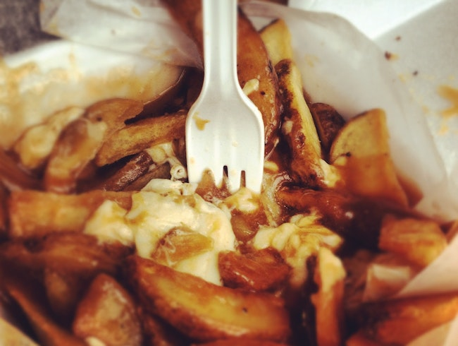 Eat poutine in Granville Island