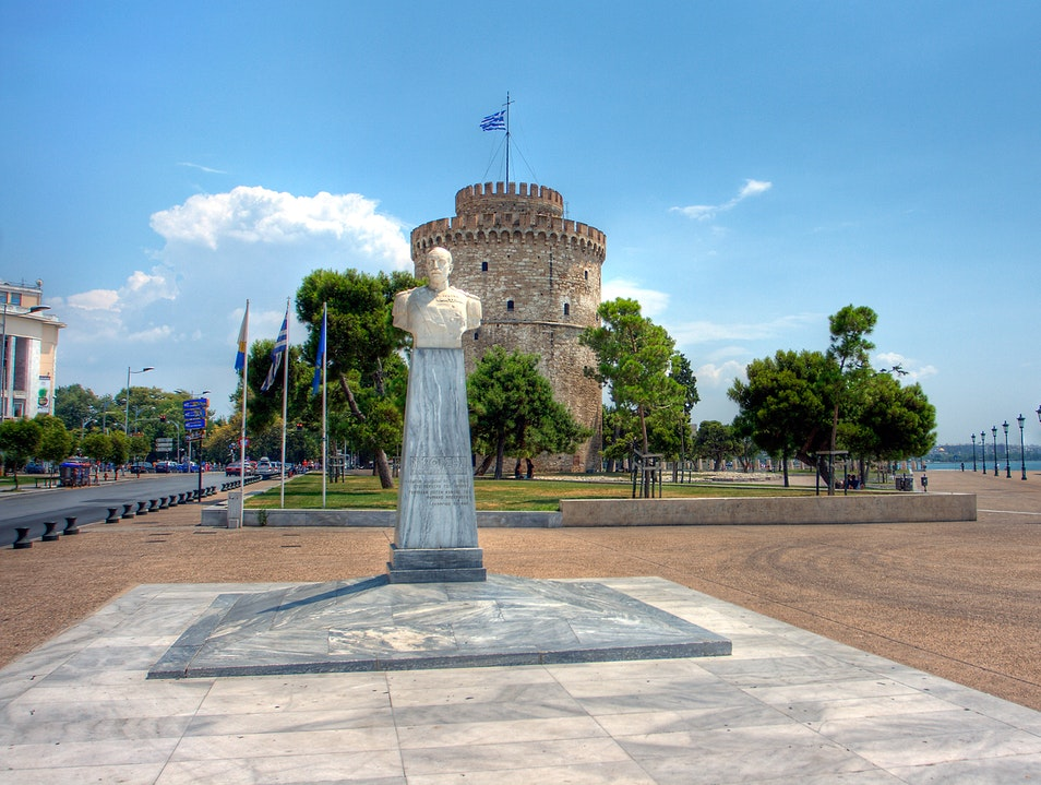 Statue of Admiral Votsi with the White Tower Thessaloniki  Greece