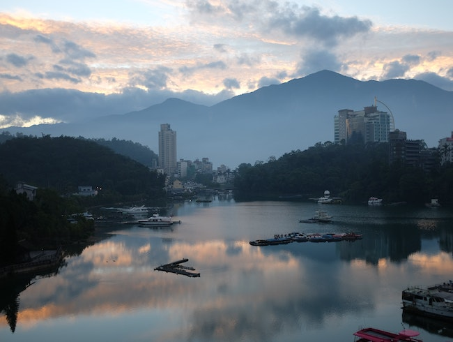 watch the sun rise over sun moon lake.