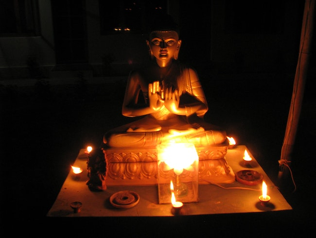 Buddha lit up by Diwali at the Root Institute in Bodhgaya, India