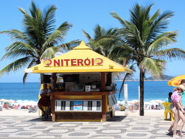Savor a fresh, cold coconut on Ipanema Beach