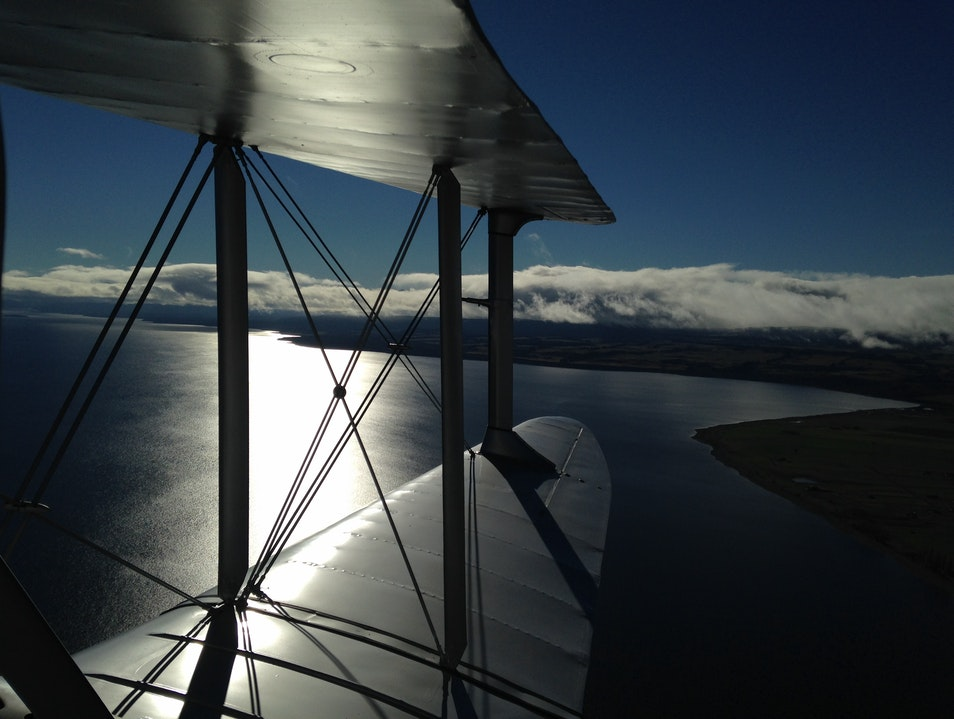 Vintage biplane flight over the fjords and mountains of New Zealand