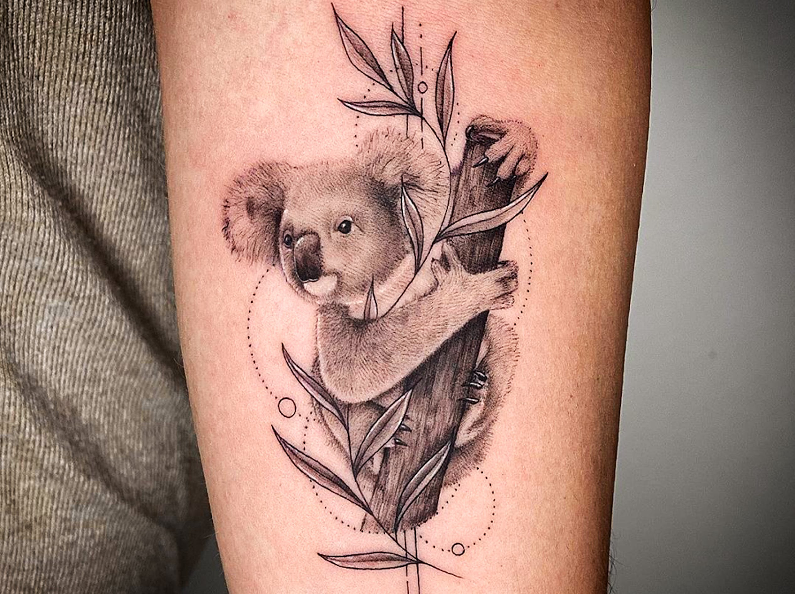 A surprising amount of realism is possible with black and gray inks. This tattoo by Kelsey van Leeuwen at New Amsterdam Tattoo Studio creates an exeptional level of detail with delicate dotwork and geometric accents.