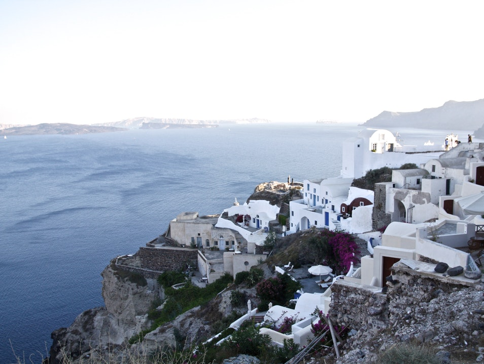 Battling hundreds of stairs to get to picturesque swimming and eating Oia  Greece