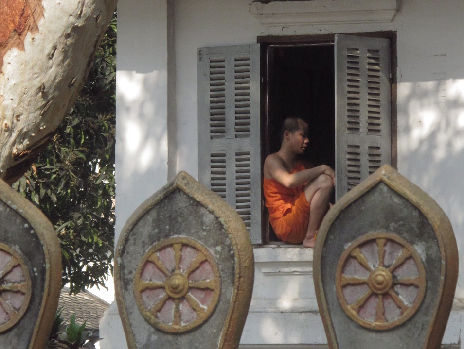 A young monk getting some air. Luang Prabang  Laos