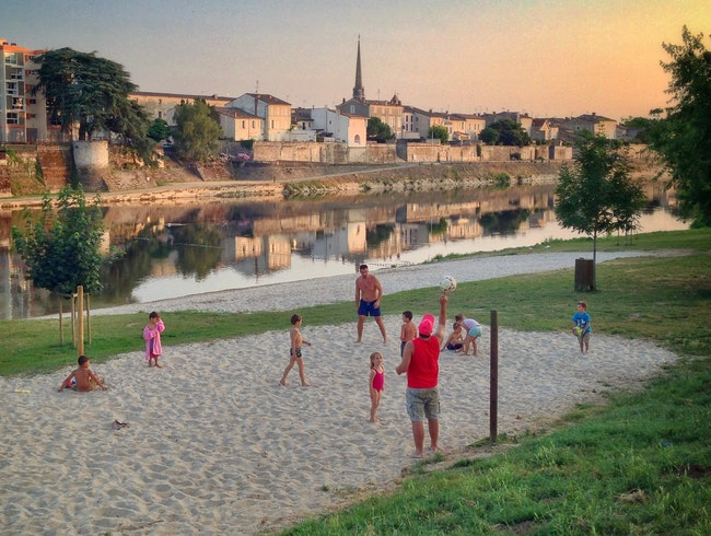 "A beach across from a ""bastide""--summer evening along the Dordogne"