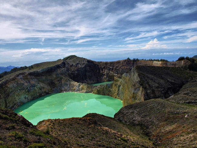 Early Morning Trekking around the Rim of Glistening Kelimutu Three-Colored Volcanic Lake