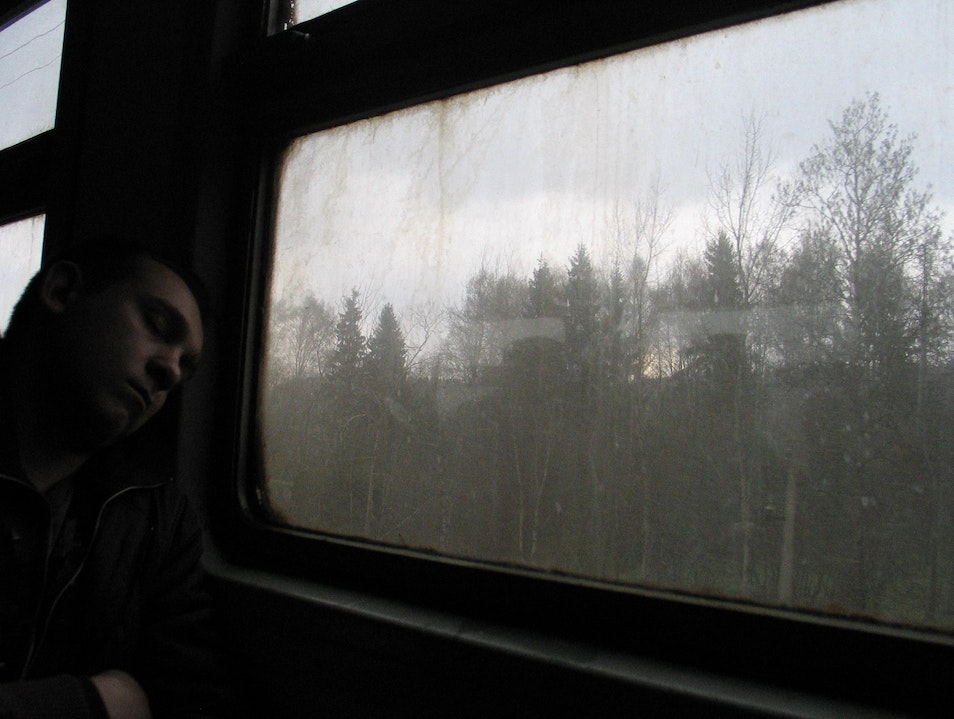 Seeing people live in a train, as they commute between towns within the Russian vastness.