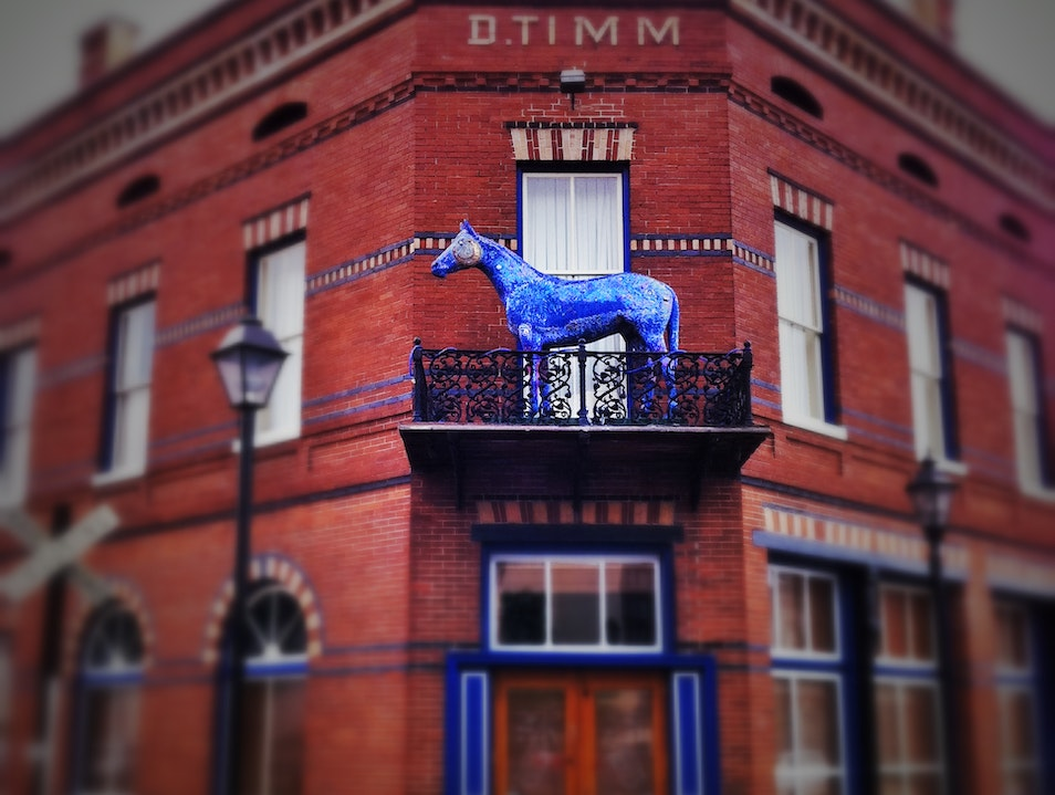 blue horse on a balcony: unlikely art