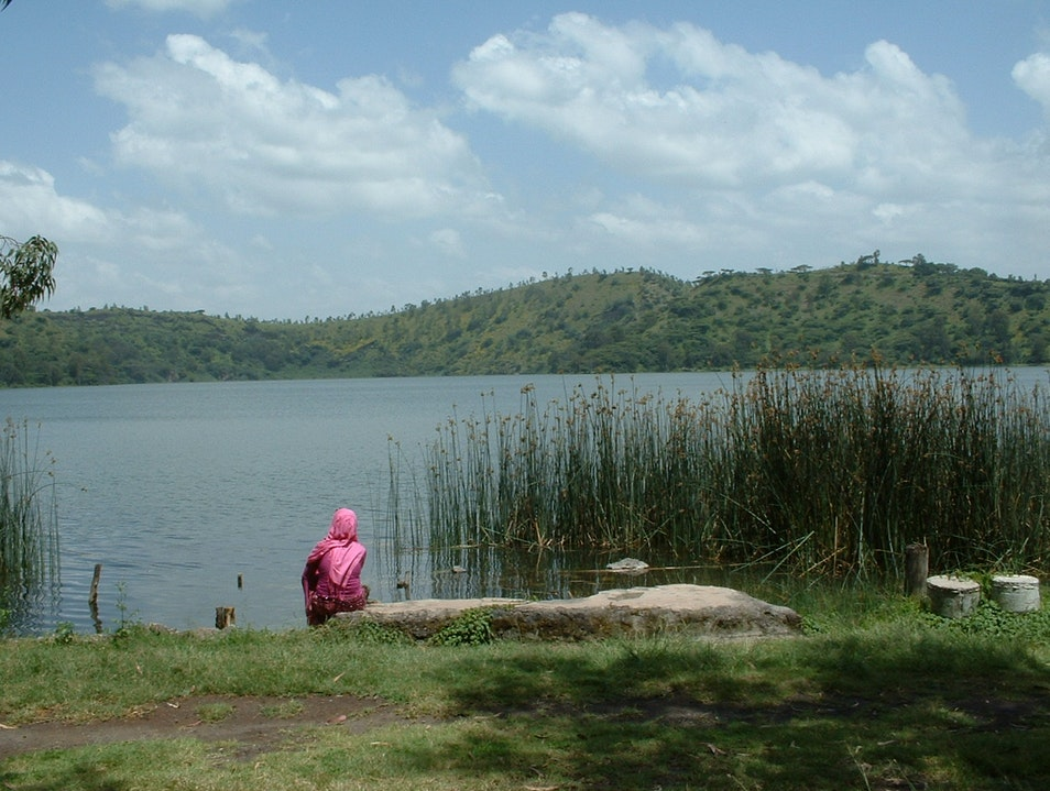 Woman meditating at Lake Hora Bishoftu  Ethiopia