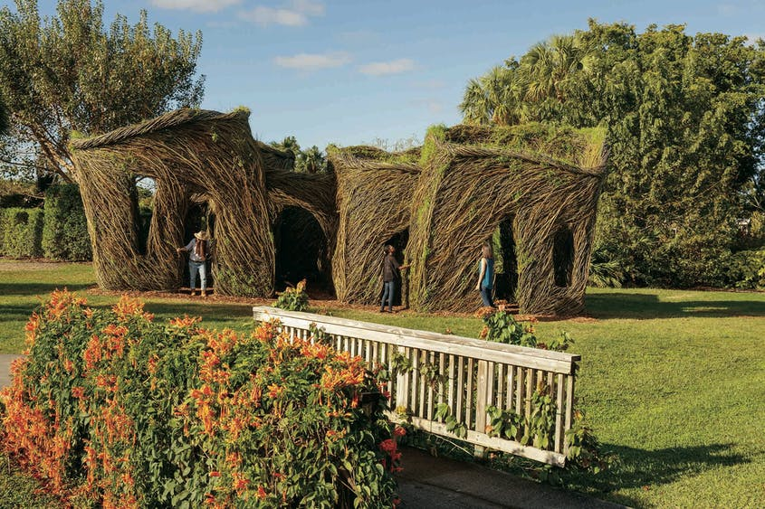 """Artist Patrick Dougherty's """"Cutting Corners: A Stickwork Exhibit,"""" made of 30,000 pounds of willow, at Mounts Botanical Garden."""