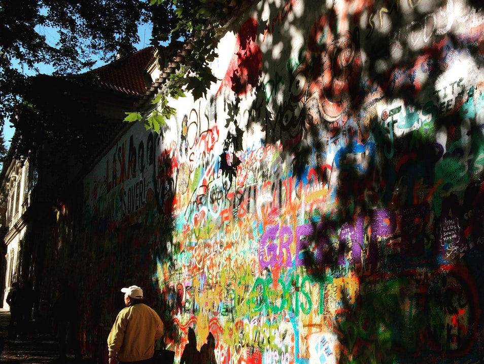 Fall light through the trees at the Lennon Wall  Prague  Czech Republic