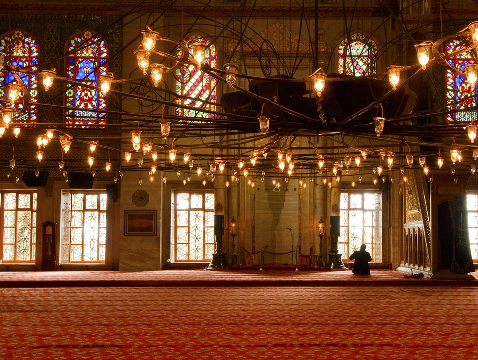 Praying at the Blue Mosque Istanbul  Turkey