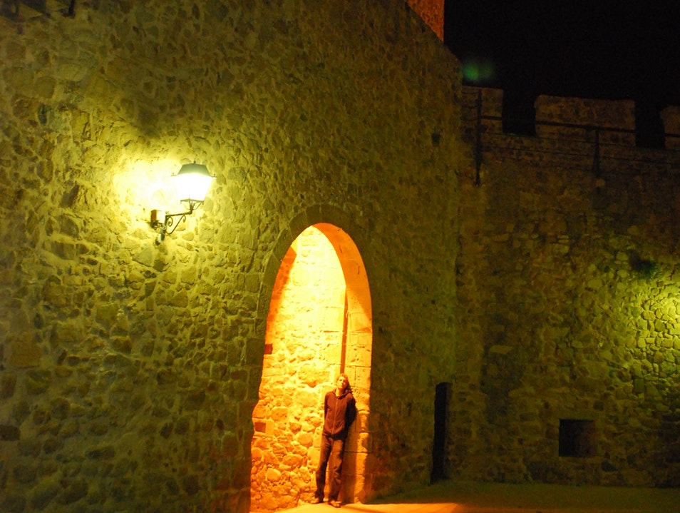 Solo evening under the glow of a Spanish fortress Tossa de Mar  Spain
