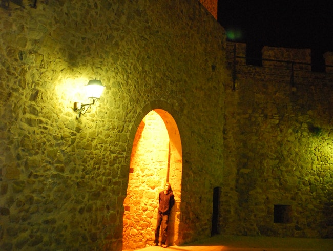 Solo evening under the glow of a Spanish fortress