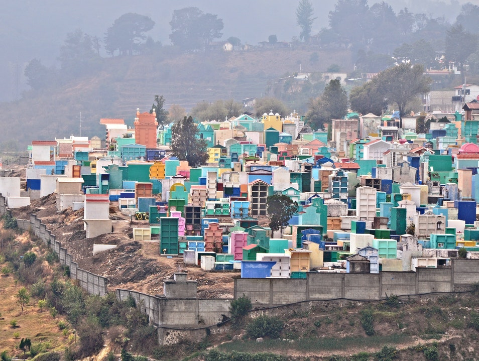 A hillside cemetery of vibrant colors