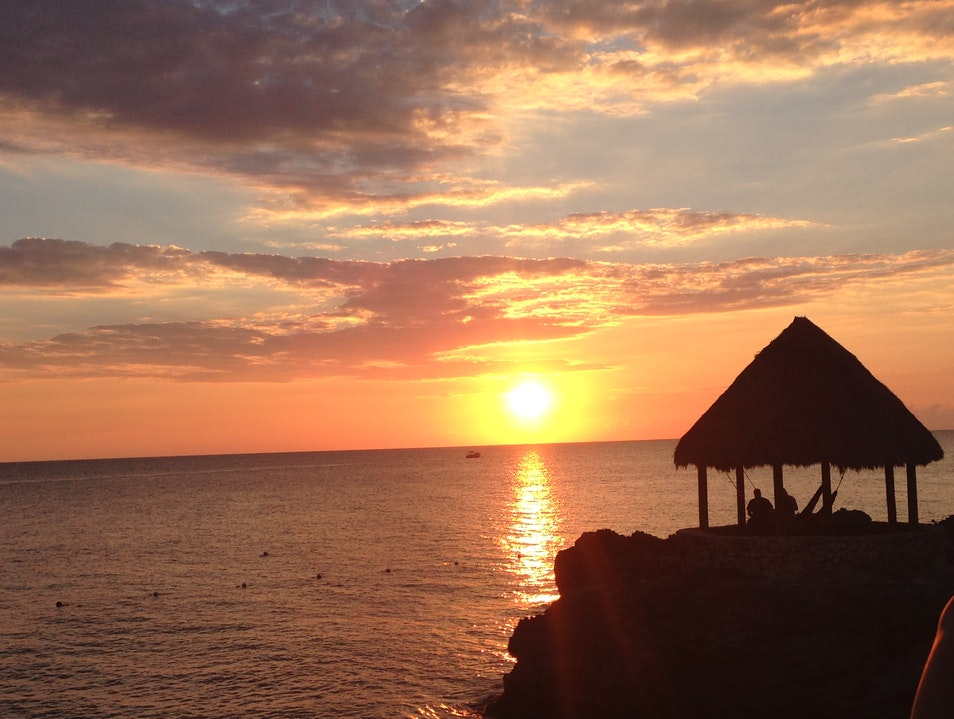 Sunset Behind the Tensing Pen Hammock Hut Negril  Jamaica