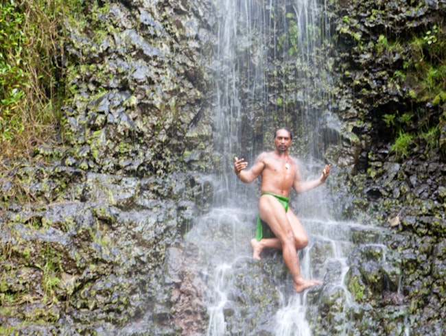 Take in a local Tahitian waterfall