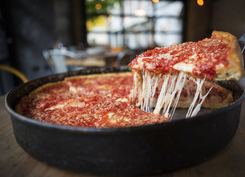 With its thick crust and layers of cheese, deep-dish pizza is a Chicago staple.