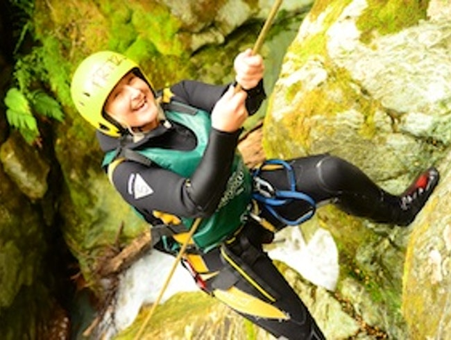 Abseiling down a waterfall in the Routeurn Canyon