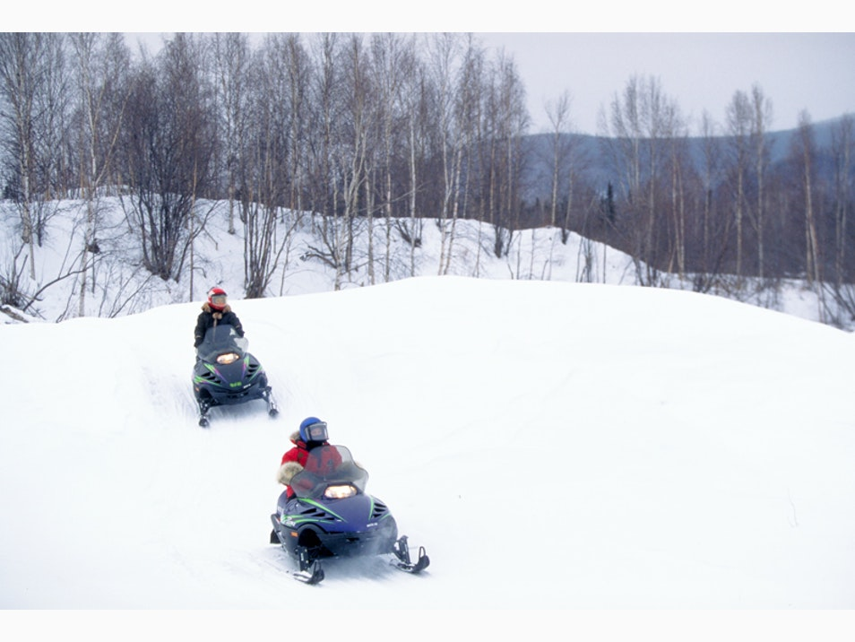 Zoom Over the Tundra on a Snowmobile