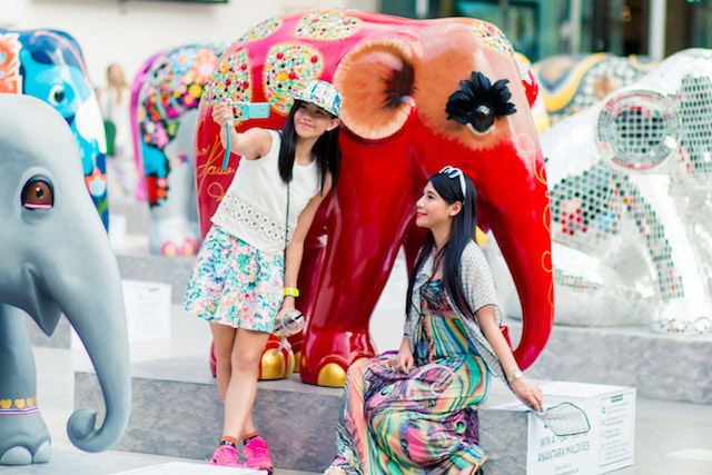 Original 2 girls taking selfie with hacuna matata by nanou herman bkk 2015.jpg?1471971710?ixlib=rails 0.3